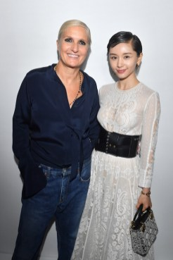 PARIS, FRANCE - SEPTEMBER 24: Maria Grazia Chiuri and Olivia Wang pose backstage after the Christian Dior show as part of the Paris Fashion Week Womenswear Spring/Summer 2019 on September 24, 2018 in Paris, France. (Photo by Victor Boyko/Getty Images) *** Local Caption *** Maria Grazia Chiuri; Olivia Wang