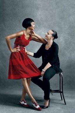 Sophie Theallet admires her desert-red dress on model Chanel Iman