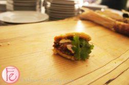 Cochinita Pibil Gordita - 'Little Fat One' (corn cake stuffed with pork, guacamole, cilantro, crema, anejo cheese, Habanero hot sauce by Jon Hamilton, La Carinta