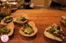 braised lamb shoulder taco prepared with mesquite aioli, advocado, and cilantro by executive Chef Graham Pelley, e11even