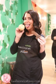 allure body bar waxologist holding vagina cupcake and penis cookie