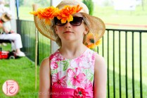 little girl in ascot hat at polo for heart 2015