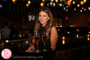 waitress with champagne at cactus club cafe