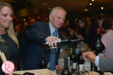 old man pouring wine