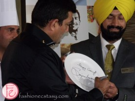 Sanjeev Kapoor autographs the first plate for Khazana, Brampton