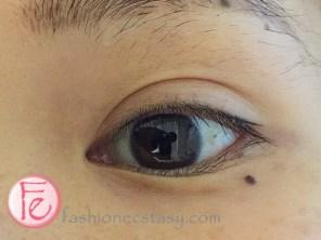 Twiggy eyeliner tattoo before touchup left eye