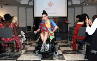 Designs by Michele Taras Art Apparel on diverse model with disability (Photo credit: Malia Indigo)