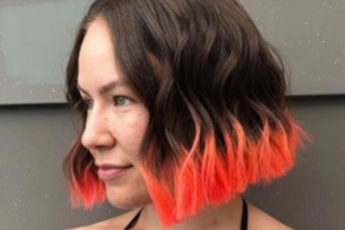 Dip Dyed Hair Is The Festival Trend That Refuses to Retire brown hair with neon coral ends