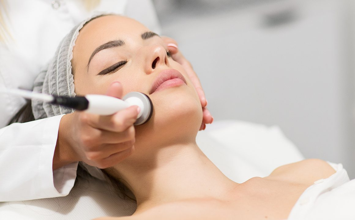 dermatology-treatments-for-youthful-skin-woman-getting-facial-treatment-main-image