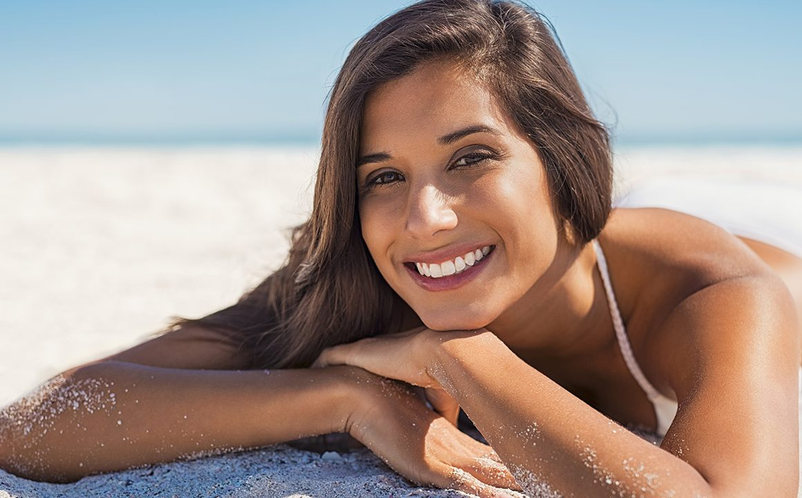 how-to-keep-your-skin-healthy-this-summer-pretty-girl-with-good-skin-on-the-beach