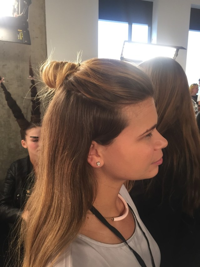 Essie manicurist Julie Kandalec backstage at NYFW, doing her job and sporting the hottest hair trend this season. Photo: Cheryl Wischhover/Fashionista
