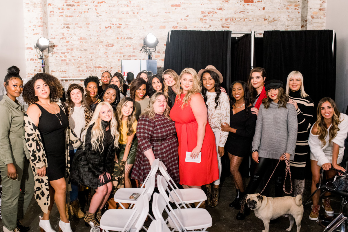 Hunter McGrady (in red, center right) at DSW's Inclusive Runway Redone Show with Create & Cultivate at Industria backstage with the models in the show. Photo: Smith House Photo/Courtesy of Create & Cultivate