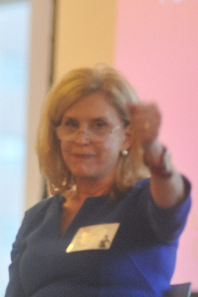 Congresswoman Carolyn Maloney, holding out fist in front of her, starting a fashion revolution!