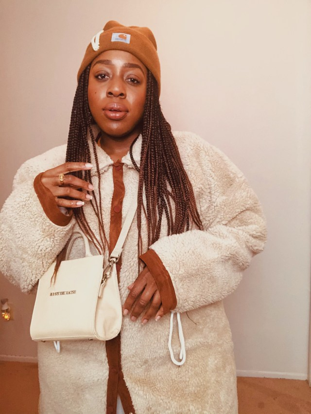 black woman in teddy coat