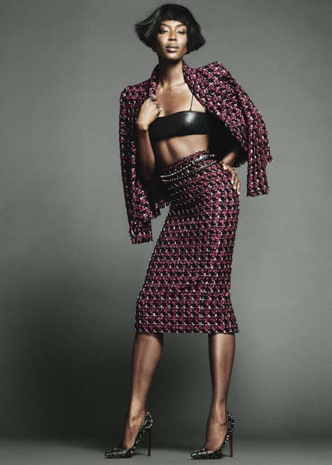 Jacket and skirt by Oscar de la Renta; top by Saint Laurent by Hedi Slimane; pumps by Christian Louboutin; earrings by Roberto Cavalli; (right hand) ring and ring by Bottega Veneta; (left hand) ring by Maison Martin Margiela; belt by Valentino