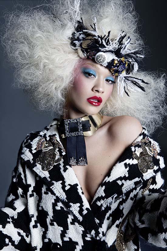 Rita Ora in Dolce & Gabbana coat, necklace and headpiece