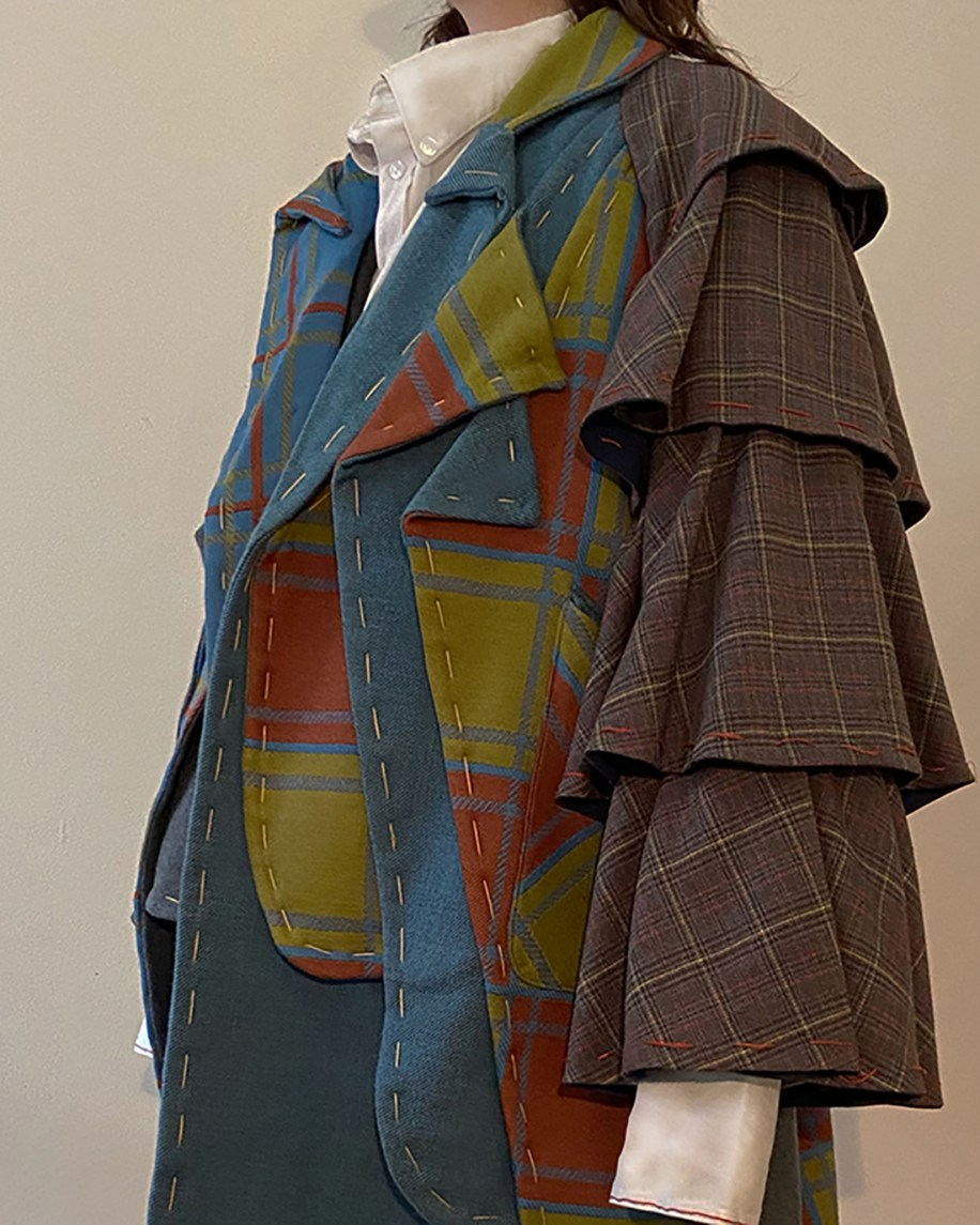 detail shot of multi plaid layered coat