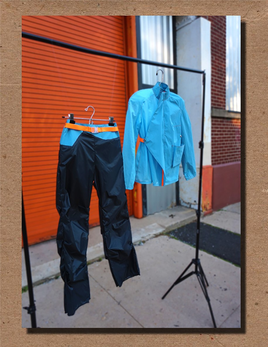 Blue cotton/ nylon asymmetric jacket and parachute/ nylon track pant