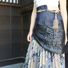 Close up of the layered skirt: side drawstring with Japanese trapunto letter on it