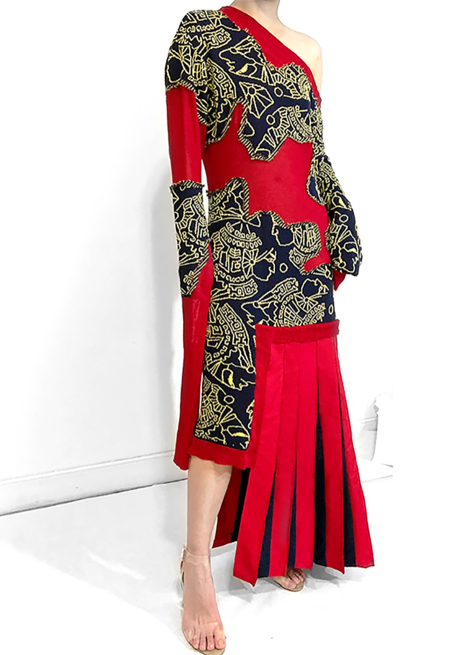 Asymmetrical drop shoulder double jacquard dress with the pattern cut out and knife pleats