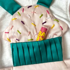 Hand-embroidered cupcake bib with pleated pocket