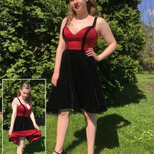 Dress with red satin bodice and velvet skirt and trim. Skirt is fully lined in red satin.