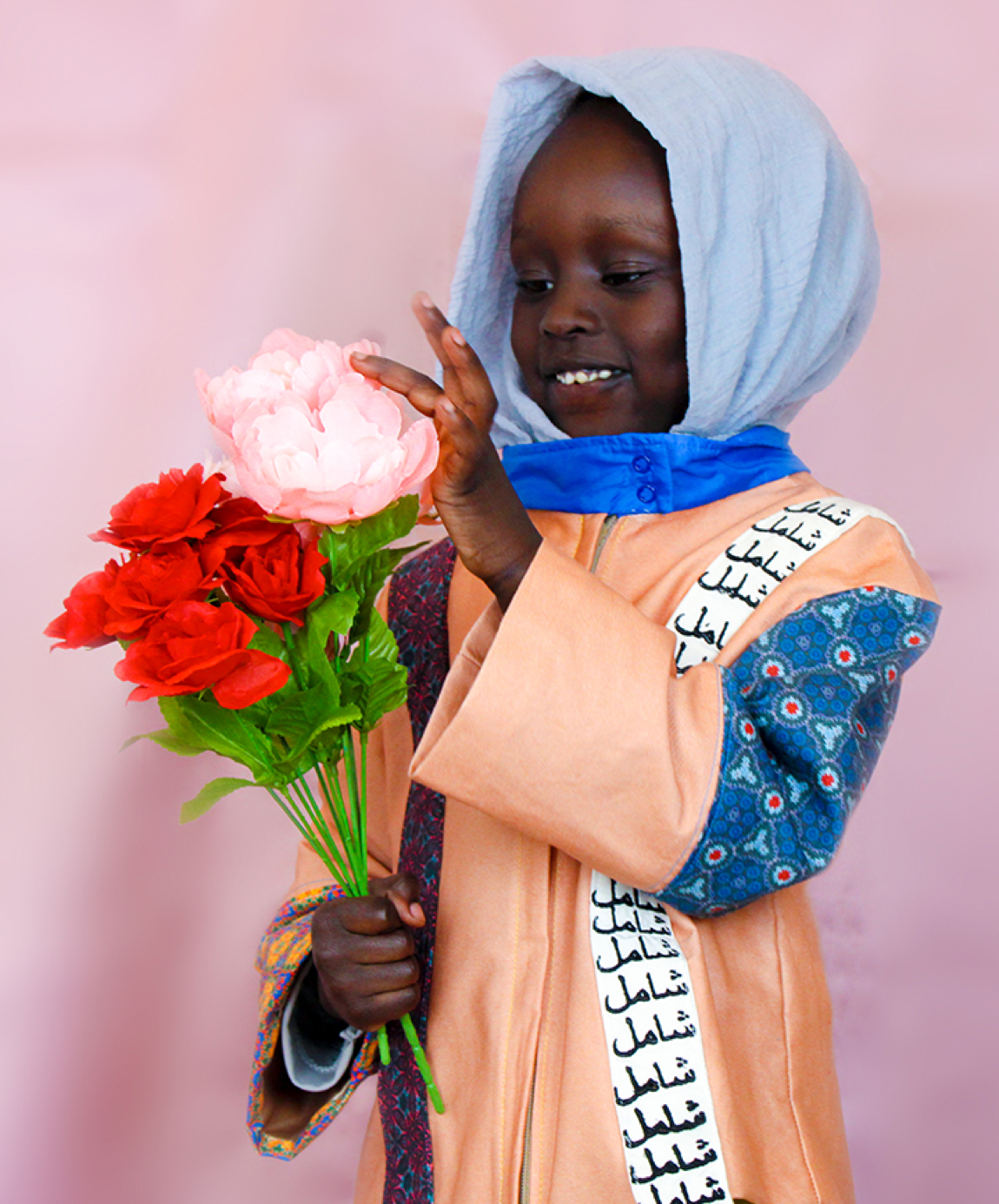 Hawwaa Ibrahim Collection Photo 1 - Child with flowers in hand