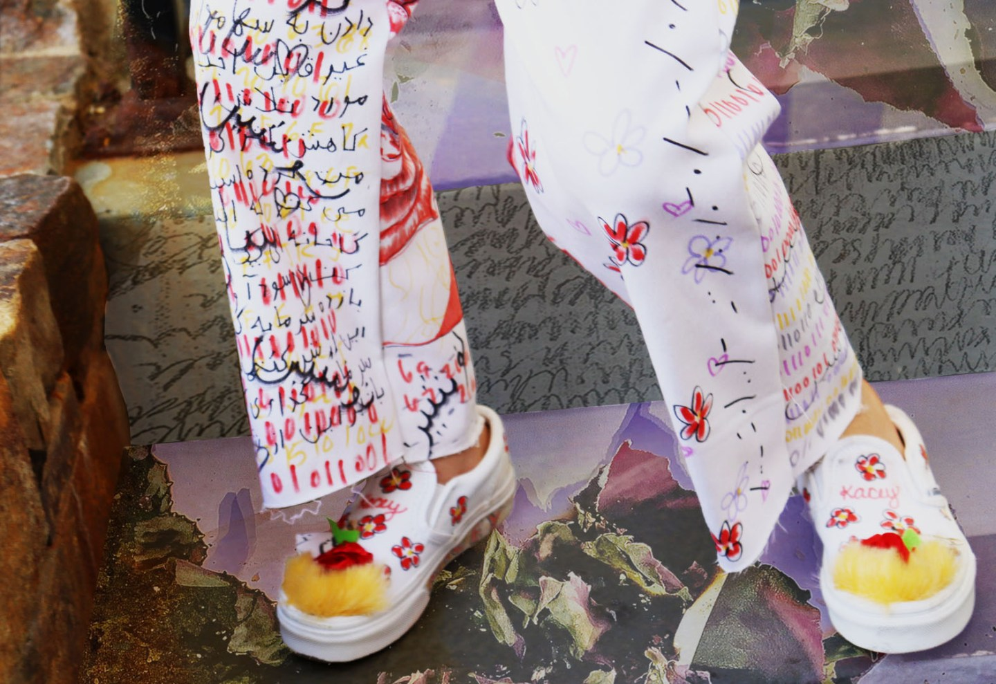 The pant consists of binary, hex, morse, code, and farsi writing. The back has an image on each side that when joined, creates one image. The shoes are custom slip-on Vans made for the model.