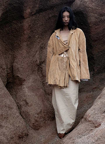 Under the thickness and distressed effects of the jacket, there is a light cotton skirt that looks classic in the front. The silhouettes, fabrications, and textures contrast greately when the pieces are put together. This suggests human conflicts that happen throughout one's lifetime.