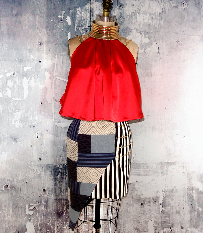 Red satin-flared halter top is paired with wrap skirt made of patchworked fabric inspired by traditional West African textiles.