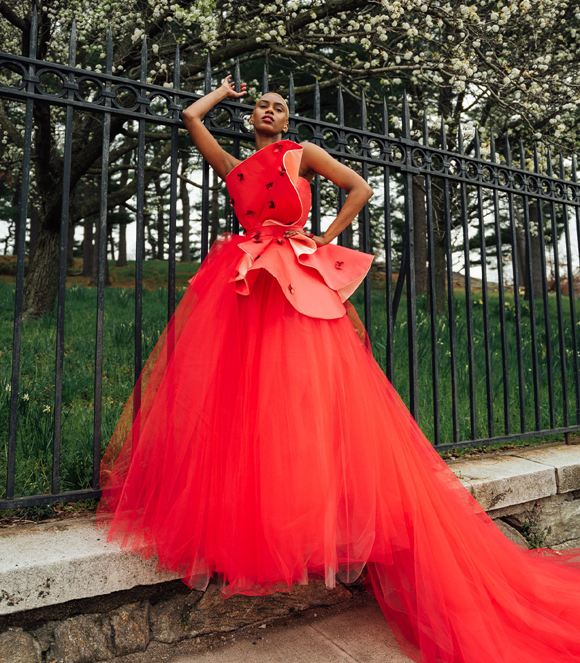 Note 1 - red satin strapless top with princess seams. Note 2 - satin structural shapes on the top embellished with sequins and beaded details. Note 3 - A-line tulle skirt with layers of red and pale pink tulle.