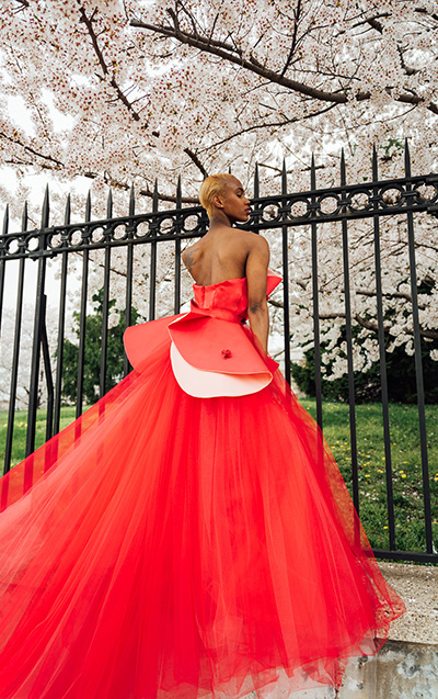 Note 1- six layers of red and pale pink tulle create an A-line shape. Note 2 - low back on the top with princess seams