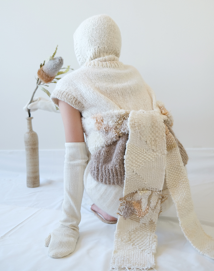 A color blocked sleeveless top, weaving straps, a white balaclava, and white woven mittens