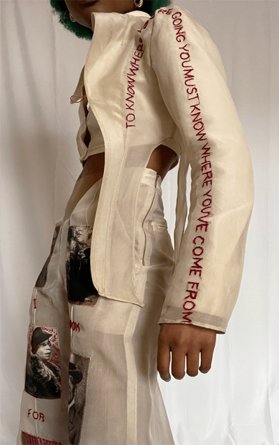 """Side profile of beige chiffon blazer with hand embroidery stating """"To know where you're going you must know where you've come from."""""""