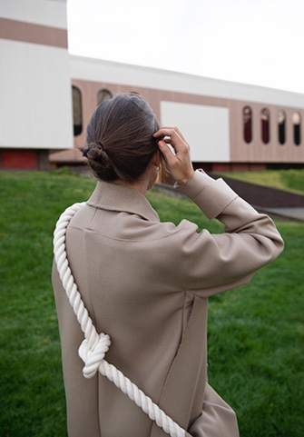 Kerrigan Steger Onno Collection Photo 3 - Back view of garment and model. Building in the background