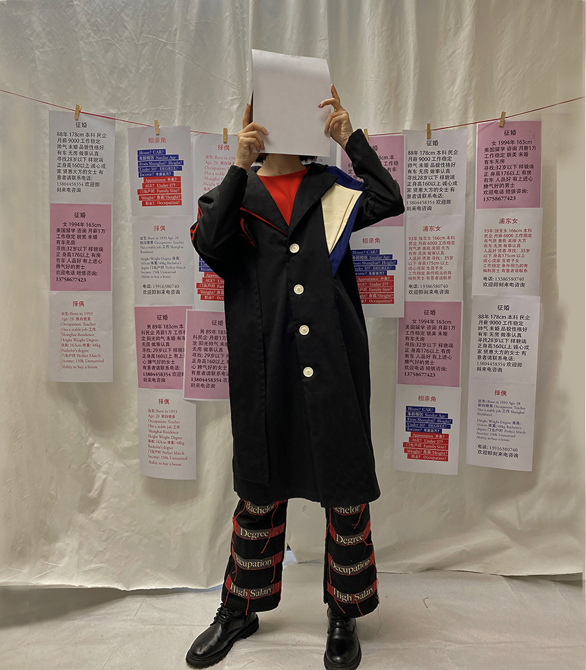 Photo 1 -  A black coat with asymmetrical lapels and a typography pants with red threads embroidery (front view)