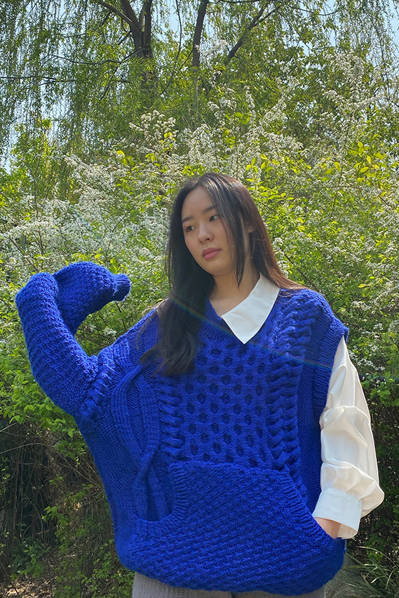 """""""The sweater is hand knit in a mix of stitches. Notably the oversize cable. """""""