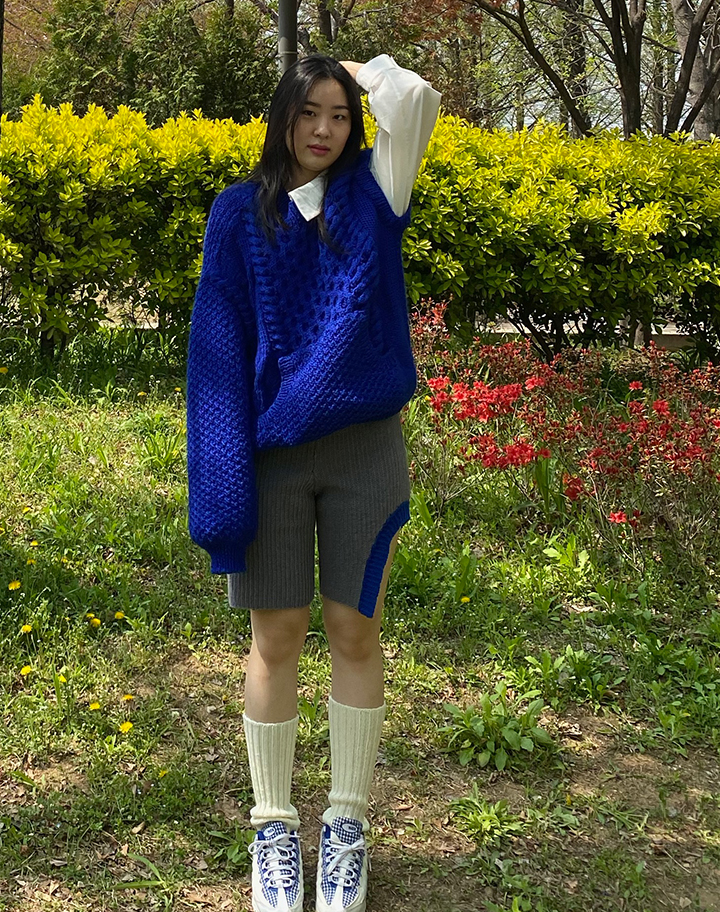 """""""The final look is completed with a 2 by 2 rib socks to keep the balance of the youthful energy in the look. """""""