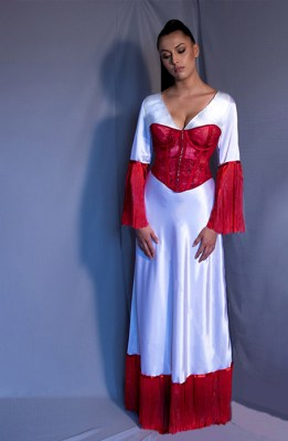 This ensemble is composed of a white bias dress worn along a red corset. The colors were specifically chosen to convey the message healing and pain.