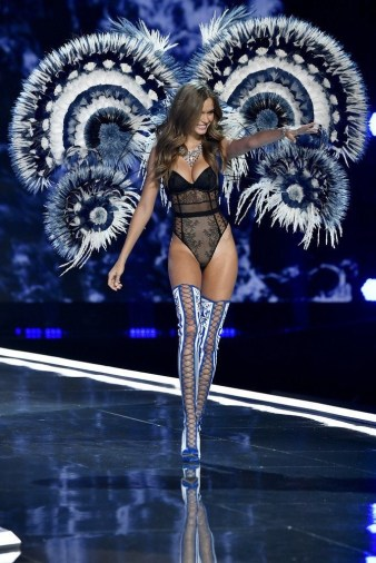 A model on the runway in wings for the Victoria's Secret fashion Show wearing all black