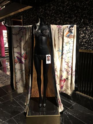 A VS Loves Kimono Cape on display