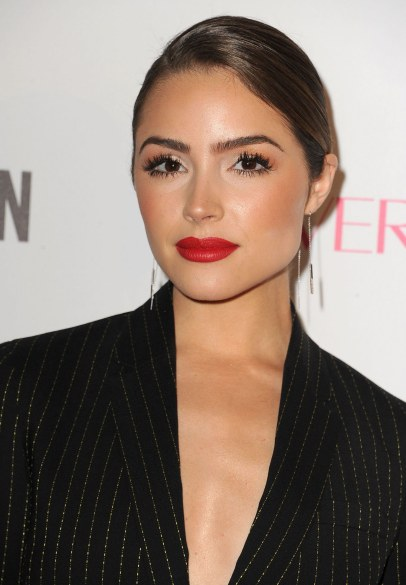 Press shot of Olivia culpo with hair tied back and red lipstick