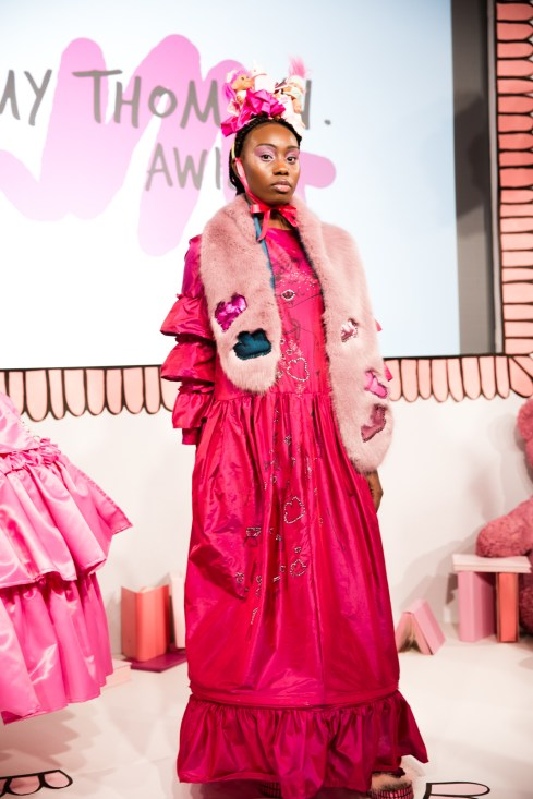 Amy Thomson FW18 Chasin' Dreams Presentation at London Fashion Week a model wearing a dress and faux fur stole