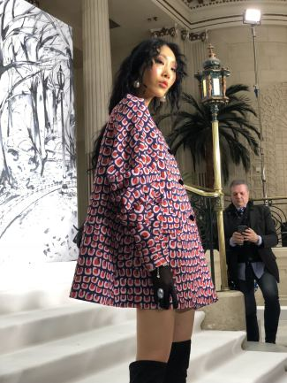 A close op of a printed swing coat in the FW18 Paul Costelloe show at London fashion Week
