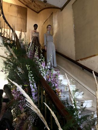 Merchant Archive FW18 LFW 2 models on a staircase strewn with flowers
