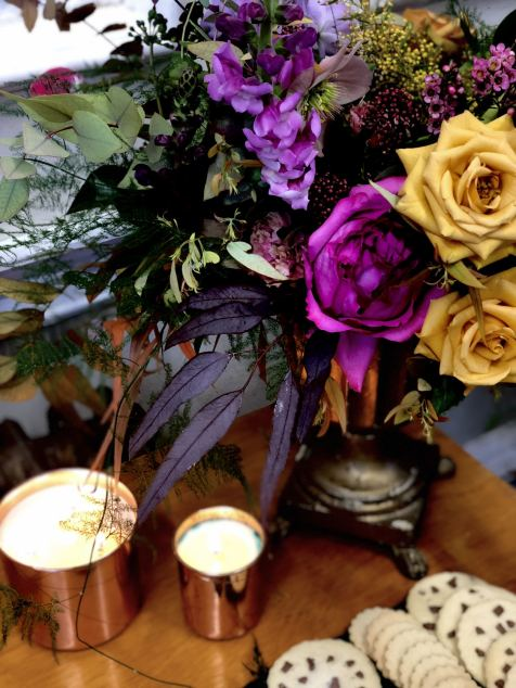 Merchant Archive FW18 LFW flowes and candles on a wooden table