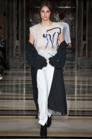 A model wears white on the runway for SOE Jakarta at london Fashion Week FW18