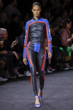 An image from the SS18 Fenty puma runway show, a model in leather motocross inspired race separates