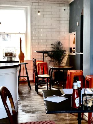 The interior of Forsyth & Reed on Clayton Road, overlooking the kitchen and serving area.