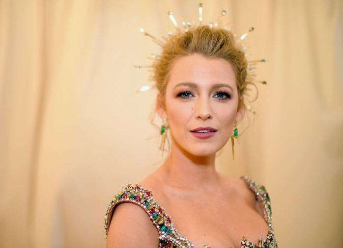 A close up image of Blake lively's beauty look at the 2018 met gala topped off with gold circle crown